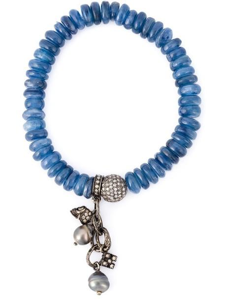 women embellished gold blue jewels