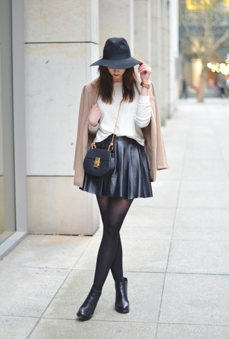 vogue haus blogger hat leather skirt white sweater camel coat