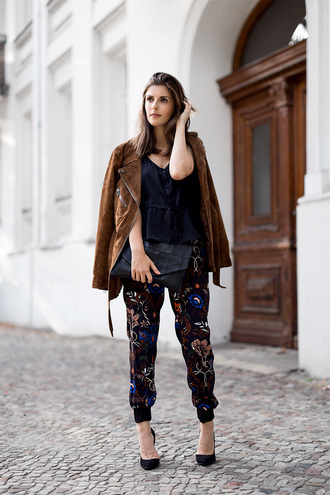jacket black top brown suede jacket floral print pants black heels blogger