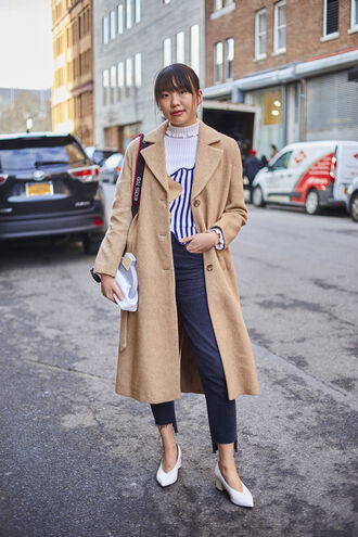 bag nyfw 2017 fashion week 2017 fashion week streetstyle denim jeans blue jeans cropped jeans sweater printed sweater striped sweater coat camel camel coat white bag shoes white shoes glove heels mid heel pumps