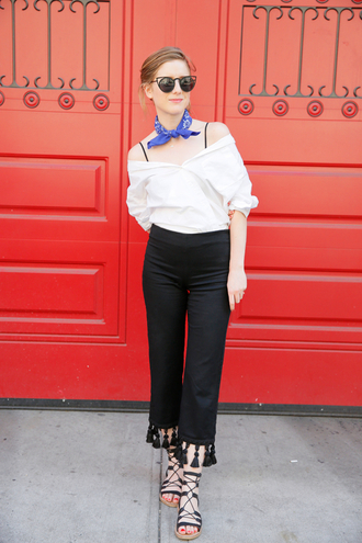 man repeller blogger top shoes sunglasses jewels white top off the shoulder top flat sandals black pants