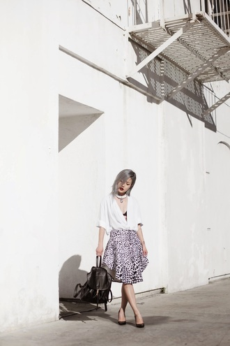 feral creature blogger skirt white top print