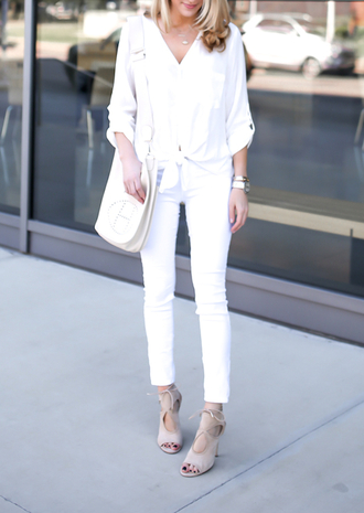 krystal schlegel blogger jewels bag all white everything white blouse long sleeves white bag white jeans nude heels