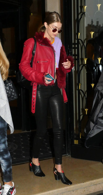 jacket red jacket paris fashion week 2016 gigi hadid streetstyle model off-duty crop tops fall outfits fur collar jacket celebrity style celebrity leather jacket pants black pants black leather pants leather pants sunglasses round sunglasses slingbacks black shoes