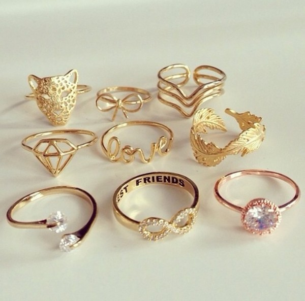 jewels jewelry beautiful gold gold jewelry girl girly diamonds tiger ring ring feathers feathers infinite love cute gold ring infinity best friends infinity ring bff