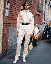 jumpsuit,long sleeves,belt,western belt,white boots,high heels boots,handbag,earrings