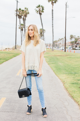 eat sleep wear blogger sweater jeans shoes bag top fringed top fringes white top short sleeve black bag chanel chanel bag chanel boy blue jeans sandals black sandals wedges wedge sandals