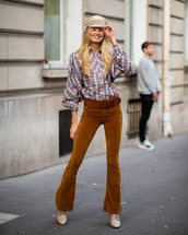 pants,flare pants,belt,checkered shirt,long sleeves,shoes,cap