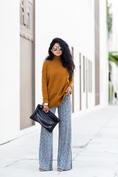walk in wonderland,blogger,rust,turtleneck,wide-leg pants,pouch,round sunglasses,top,pants,bag,jewels,sunglasses