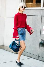 sweater,tumblr,red sweater,bell sleeves,skirt,blue skirt,mini skirt,shoes,mules,black shoes,bag,black bag,slide shoes,loewe bag,sunglasses,streetstyle,bell sleeve sweater,ruffle sweater