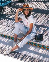 pants,hat,tumblr,cropped pants,stripes,striped pants,espadrilles,shoes,t-shirt,white t-shirt,sun hat,sunglasses,bag,black bag