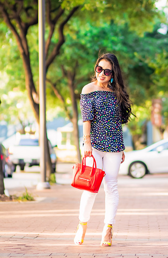 cute & little blogger top jeans shoes bag jewels sunglasses off the shoulder off the shoulder top floral top polka dots white jeans white pants celine celine bag red bag yellow