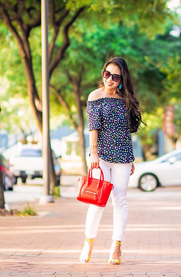 cute & little blogger top jeans shoes bag jewels sunglasses off the shoulder off the shoulder top floral top polka dots white jeans white pants celine celine bag red bag yellow