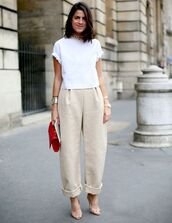 bag,white top,pants,beige pants,red bag with golden metals,top,wide-leg pants
