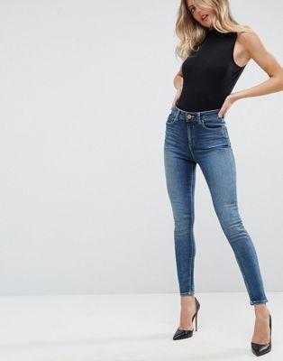 ASOS DESIGN Ridley high waist skinny jeans in extreme dark stonewash blue at asos.com