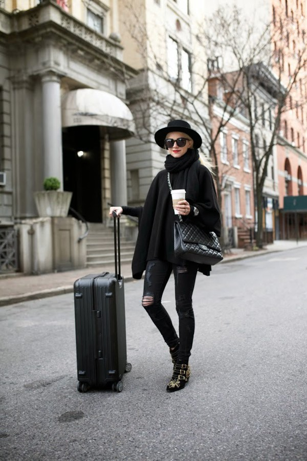 atlantic pacific blogger hat sunglasses ripped jeans studded shoes ankle boots susanna boots black jeans denim jeans sweater black sweater scarf all black everything suitcase bag quilted bag chanel buckles buckle boots black hat