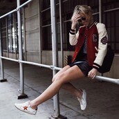 jacket,tumblr,red jacket,skirt,mini skirt,black leather skirt,leather skirt,sneakers,white sneakers,low top sneakers,baseball jacket,teddy jacket,bomber jacket