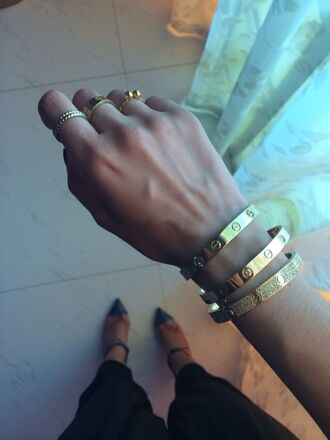 jewels celine bracelets love bracelets shoes ring gold jewelry kylie jenner jewelry keeping up with the kardashians stacked bracelets arm candy gold jewelry hand