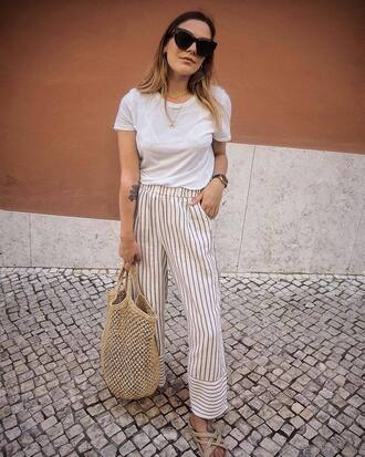 pants tumblr stripes striped pants wide-leg pants t-shirt white t-shirt bag tote bag woven bag sunglasses necklace gold necklace top shoes sandals flat sandals