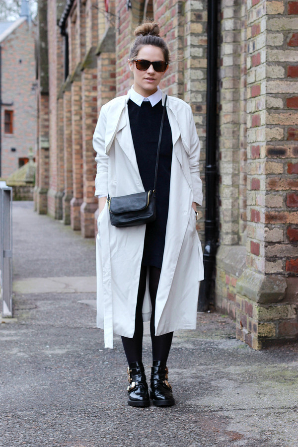 the little magpie coat dress shoes shirt bag patent boots tight opaque tights white coat duster coat trench coat crossbody bag black bag sunglasses mini dress black dress fall outfits white long coat