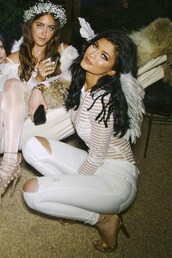 see through,stripes,kylie jenner shirt,angel wings,angel,angel outfit,halloween,halloween costume,kylie jenner,white blouse,celebrity halloween costume,shirt,kylie jenner's sheer white striped top