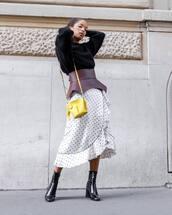 sweater,black sweater,knitted sweater,wrap skirt,polka dots,wrap ruffle skirt,ankle boots,shoulder bag,belt,earrings