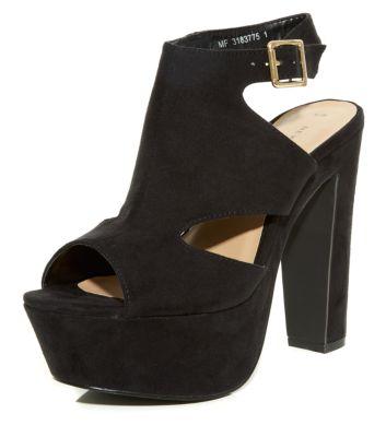 Chaussures talons à plateforme noires avec empeigne haute et découpes