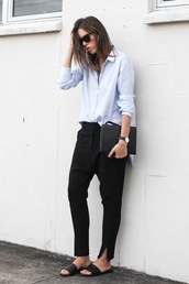 le fashion image,jewels,bag,shoes,shirt,pants,straight pants,slit pants,Gender Neutral,no gender,equality,minimalist,minimalist shoes,slide shoes,black slides,black satchel,black pants,boyish,blue shirt,light blue,spring outfits,office outfits