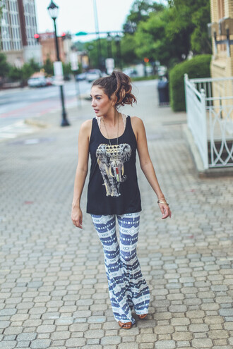 tank top top graphic tee graphic print graphic tank top aztec elephant elephant print entourage affordable summer summer outfits style trendy tribal pattern burgundy black flare pants flare