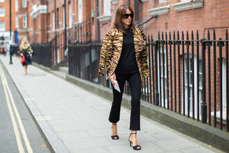 pants fashion week street style fashion week 2016 fashion week london fashion week 2016 kick flare kick flare pants black pants cropped pants top black top jacket animal print sunglasses fall outfits streetstyle sandals sandal heels black sandals high heel sandals