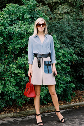 vanessa jackman,blogger,skirt,suede,sandals,red bag,blouse,medium-size belt,sweater,shoes,zipped skirt,zip-up skirt,grey skirt,a line skirt,belt,black belt,blue shirt,handbag,sunglasses,brown sunglasses