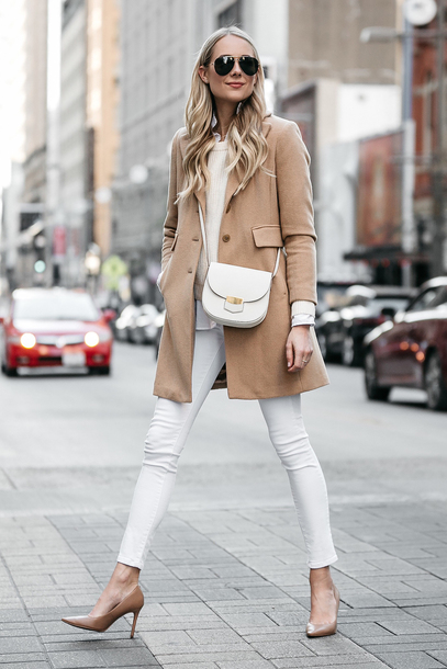 fashionjackson blogger coat shirt sweater shoes bag sunglasses jewels crossbody bag white pants pumps beige coat winter outfits tumblr camel camel coat white bag denim jeans white jeans pointed toe pumps high heel pumps
