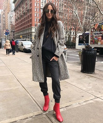 coat grey coat sweatpants black pants black top boots red boots pants black sweatpants top ankle boots