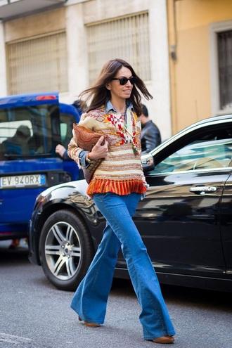 top printed top sunglasses clutch tassel jeans denim blue jeans flare jeans streetstyle bag