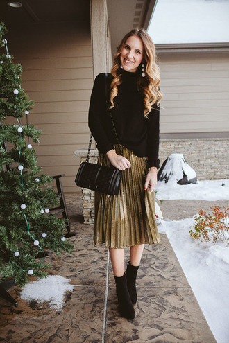 twenties girl style blogger sweater skirt jewels shoes bag shoulder bag midi skirt gold skirt pleated skirt ankle boots black sweater black and gold metallic skirt earrings black booties rebecca minkoff winter outfits winter look