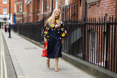 skirt,fashion week street style,fashion week 2016,fashion week,midi skirt,high waisted skirt,blue skirt,wrap skirt,printed top,puffed sleeves,top,multicolor,sandals,sandal heels,high heel sandals,gold sandals,bag,j w anderson,red bag,fall outfits,streetstyle,J.W.Anderson bag