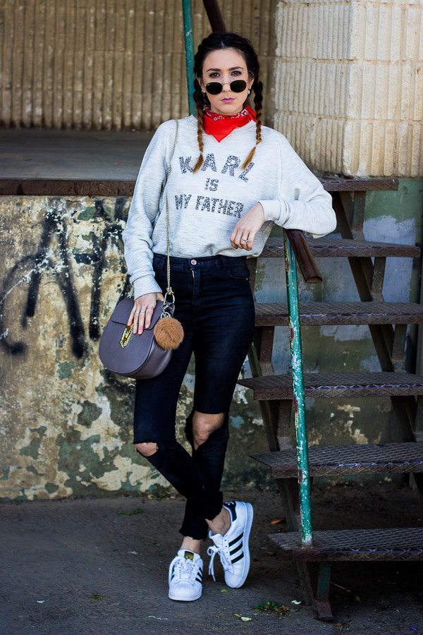 shoes and basics blogger quote on it grey sweater round sunglasses blue bag black jeans ripped jeans white sneakers adidas shoes karl lagerfeld