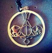 jewels,harry potter,percy jackson,divergent,the hunger games,gold,circle,pendant,cute,book,movies