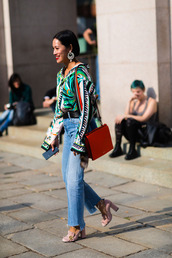 shoes,fashion week street style,fashion week 2016,fashion week,milan fashion week 2016,blue jeans,denim,jeans,pink shoes,pumps,high heels,gucci shoes,gucci,shirt,printed shirt,bag,red bag,earrings,streetstyle,pilgrim shoes,high heel loafers