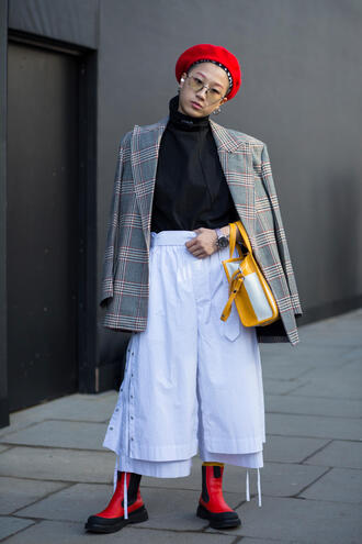 hat red hat london fashion week 2017 fashion week 2017 fashion week streetstyle beret pants white pants palazzo pants cropped pants boots red boots flat boots top black top blazer printed blazer bag yellow yellow bag