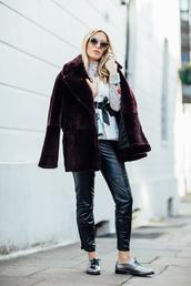 camila carril,blogger,sweater,shirt,top,pants,coat,fur coat,black leather pants,derbies,metallic shoes,oxfords,leather pants,black pants,cardigan,burgundy