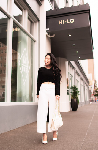 cute & little blogger top shoes bag jewels white bag white heels high heel pumps black top white pants