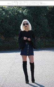 the black effect,blogger,shoes,bell sleeves,black top,long sleeves,black blouse,button up denim skirt,button up skirt,denim skirt,knee high boots,suede boots,black boots,round sunglasses