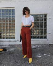 pants,tailoring,wide-leg pants,boots,belt,crop tops,sunglasses,handbag
