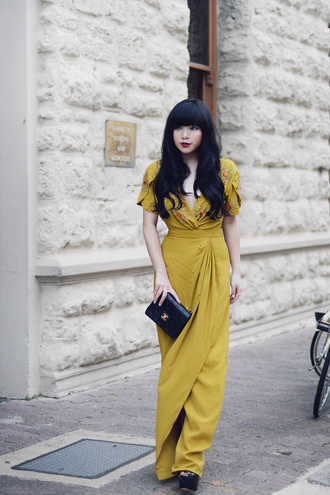 blogger mustard mustard dress short sleeve maxi dress wrap dress chanel chanel bag black bag embroidered embroidered dress