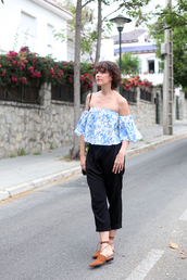che cosa,blogger,top,pants,bag,blue off shoulder top,blue top,printed top,off the shoulder,off the shoulder top,cropped pants,black pants,camel babouches,babouches,sandals,flat sandals,spring outfits