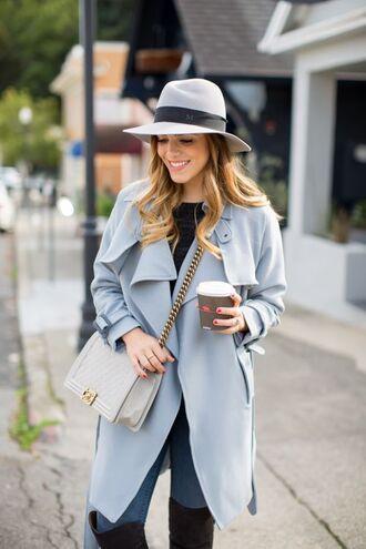 coat blue trench coat grey hat white and gold handbag skinny jeans blogger