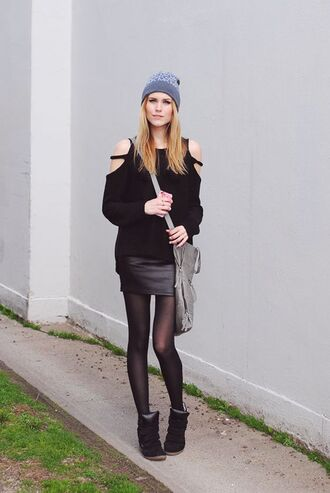 sweater cut-out shoulder sweater black sweater long sleeves cut out shoulder skirt mini skirt black leather skirt leather skirt tights sneakers high top sneakers black sneakers grey bag crossbody bag bag beanie grey beanie fall outfits