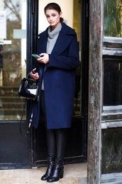 blogger,coat,sweater,bag,pants,shoes,leggings,Taylor hill,patent leather bag,black bag,handbag,blue coat,winter coat,turtleneck sweater,grey sweater,black leather pants,leather pants,black pants,boots,black boots,high heels boots,model,patent bag