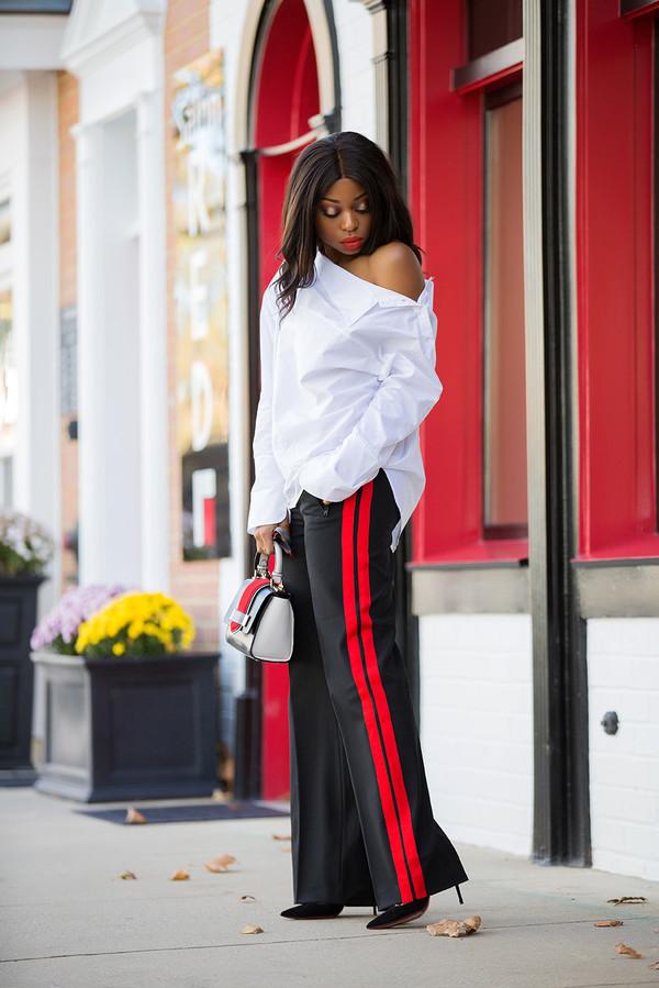 jadore-fashion blogger jewels handbag high heels blouse striped pants off the shoulder white shirt black girls killin it red pants style gucci melanin african american